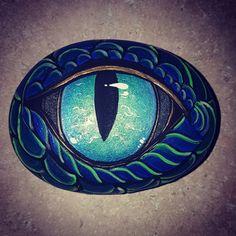 Painted rocks by Rachel Dooley. dragon eye. This one glows