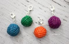 Polymer Clay Yarn Ball Stitch Markers - Repeat Crafter Me  Make these into loom knitting stitch markers by getting bigger lobster claws or large clasps