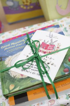 Baby Shower - instead of a card with their gift, guests bring a children's book with a handwritten message inside the cover. Absolutely love this idea!!!