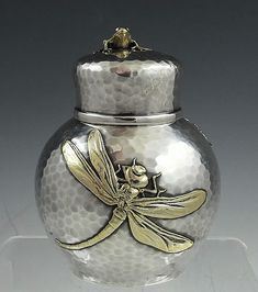 Tiffany hammered applied tea caddy with dragon and fly and frog