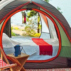 Get off the ground - the best way to make camp feel luxurious. Get an air mattress or double cot and bring along the stemware. Check out that tent lantern!