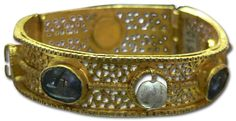 """""""Typical Byzantine bangle with hinge. Opus interrasile goldwork with large cabochon gems set in collets and pearls."""" (quote) via university.langantiques.com"""
