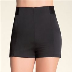 """Bebe High Waist Zip Mini Shorts Size 4 These are a great pair of sexy black shorts from Bebe.  They feature a back zip closure & a light band midsection & they are a size 4.  They are super comfortable & they have a very flattering fit that accentuates your hips.  They are made of an acetate, nylon & spandex blend, and the measurements are: Rise 10""""; inseam 2""""; leg opening 24"""".  These sleek & high waist mini shorts will have all eyes on your seductive figure! bebe Shorts"""