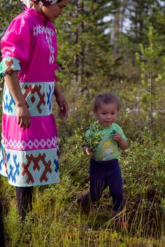 Khanty mother and son. Look at the beautiful needlework on her dress.