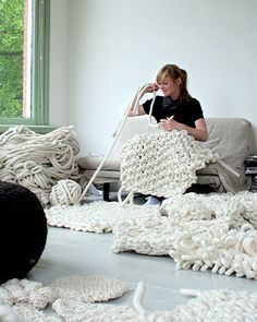 Large scale knitting. The piece that she has in her lap would make such a great rug. Hmmmm #knit