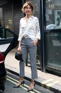 Alexa Chung mixing prints like a pro in a floral button up + checked pants and lace-up ballet flats
