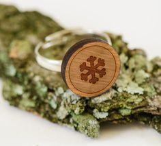 Our wooden Snowflake ring is perfect as a wedding gift, gift for dad, mom, groomsmen gifts, or just an amazing conversation starter! Express yourself with our selection of over 8,000 shapes, rings, earrings, tie clips, cufflinks, and more.  WoodenAccessoriesCo crafts one of a kind wooden suit & tie accessories with over 1,000 unique designs and products. Our wooden tie clip is made with a slip on bar in the back, which gives the product a truly clean and slender design.  Choose from our s...
