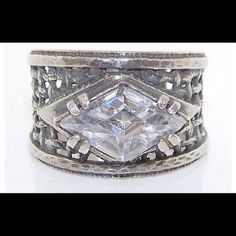 Sterling silver wide band ring w/marquise CZ NWOT Silpada .925 sterling silver basket-weave design wide band ring w/marquise cubic zirconia. Stamped with Silpada logo and .925 Israel. R1737 retired. Size seems to fall between 6 & 7 (see last image). Trades/PP/Holds Price FIRM UNLESS BUNDLED Kept in jewelry box with Silpada anti-tarnish squares. Does not come in original box. NEVER WORN! Silpada Jewelry Rings