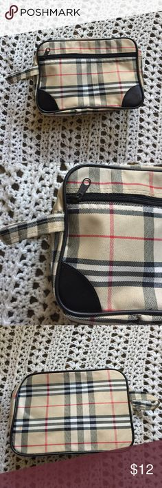 Neat Check/Plaid Travel Cosmetic/ Toiletry Bag 🖤 Excellent condition! Never been used! Unbranded ~this is a neat, medium sz. travel, cosmetic, or toiletry bag! A neat tan, red, white & black checkered or plaid design in a vinyl like somewhat soft material outside & trimmed in a black Faux Leather/vinyl like material. More of a medium sz. this measures approx. 10.5' X 7'. It zips shut w/ 1 main area inside & also has a zippered pocket on the outside front. Has a wristlet type handle for…