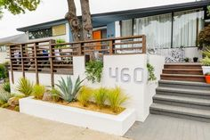 Check out this sleek modern exterior with potted plants after the landscape makeover on HGTV's Curb Appeal.