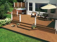 Composite decking offers some big advantages. No need to paint, stain or seal every year, and it is usually better at resisting mildew and warping, which makes it good choice for pools or hot tubs. Photo by TimberTech.