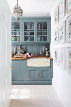 Explore our kitchen design ideas on HOUSE by House & Garden, including this fresh, bespoke green kitchen with brass fixings and butler sink.