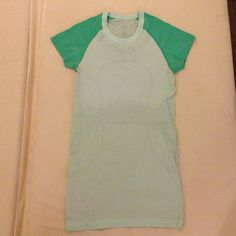 NWOT Lululemon Green Teal Run Swiftly Tech Tee 4 NWOT! Only worn twice! Super cute two-tone tee in rare, hard-to-find colors: Very Green and Fresh Teal. lululemon athletica Tops Tees - Short Sleeve