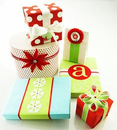 Brightly colored wrapping paper paired with creative ribbons and bows create gifts almost too pretty to open! http://www.bhg.com/christmas/gift-wrapping/last-minute-gift-wrapping/?socsrc=bhgpin122314playfulpresents&page=19