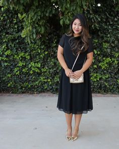 Today's church outfit on the blog: Black Midi Skater Dress, gold pointed toe pumps, gold bow purse.