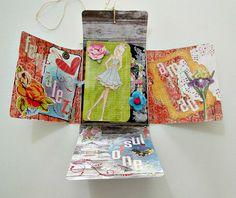 Tutorial paso a paso de Álbum carpeta con bolsillos. http://cinderellatmidnight.com/2013/10/07/nuevo-tutorial-cinderella-album-carpeta-desplegable-para-tags-atcs-y-pequenas-tarjetas-de-felicitacion/