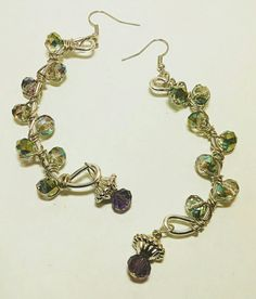 Stunning handcrafted wire wrapped and glass bead earrings. Approximately 3 inches long in length.