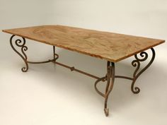 Hand wrought iron table with marble top by artfirm.us