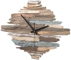 Stunning clock from driftwood (http://www.completely-coastal.com)