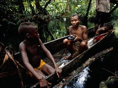 Photo of the Day debuted on April 21, 2001, with this photograph of a Pygmy family setting out for a fishing trip in a flooded forest in the Congo