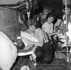 "The women of the Vietnam War - Flight nurses (aka: ""Nam Angels"") care for wounded men being transported."
