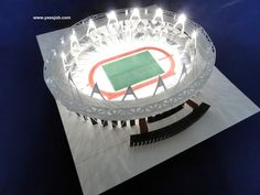 Pop Up Olympic Stadium London. Pop up Origami Architecture. This is made with paper entirely. The building design is base on London Olympic Stadium. It can be opened flat and folded again and has 14 working intense spotlights Olympic Stadium London, Pop Up Card, Origami Architecture, Spotlights, Paper Models, Building Design, Olympics, Paper Crafts, Base