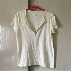 J. Crew Cotton T Light, airy, 100% cotton top with low-cut silver sequin embellishment. Perfect for a summer night with cropped jeans and heels! J. Crew Tops Tees - Short Sleeve