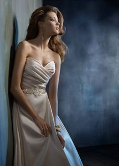 Style tk2152 Ivory Mikado bridal ball gown. Draped sweetheart bodice, crystal belt at natural waist. Ballgown skirt with box pleats, pockets and chapel train.