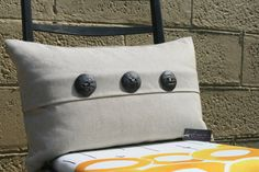 Natural linen cushion with ceramic buttons
