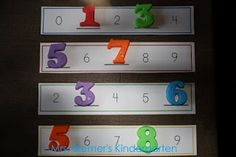Use plastic or foam numbers to fill in the missing numbers on a card stock strip.