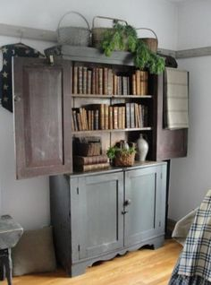 an armoire used as a bookcase... genius!