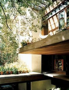 cantilevered 2nd story deck w/partial pergola above, finished ceiling below deck and reflecting pool; all under a mature tree canopy.  Built by Los Angeles architect Ray Kappe for his family, 1967.