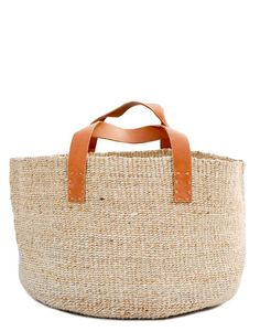 offA natural pairing of raw materials feels understated yet modern on this jute storage bin, dressed up with tanned leather handles. - Jute with leather handles - Small: diameter x high - Medium: diameter x high - Large: diameter x high