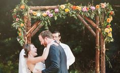 Planning a wedding inspired by the beauty of the woods? Include a rustic ceremony backdrop that complements a natural ceremony location, like a rustic huppah draped in leafy garlands or a set of  v...
