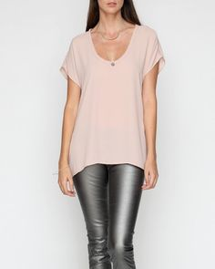 Stockholm Blouse      Super silky, lightweight blouse with soft, loose fit, featuring rounded low scooping neckline and short sleeves.