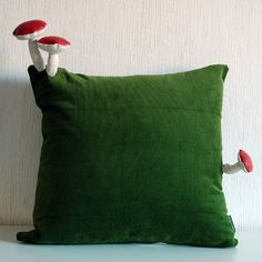 Fungimaa pillow with 3 red fake leather mushrooms