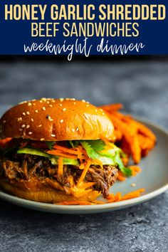 Honey garlic shredded beef sandwiches can be made ahead in the slow cooker. Topped with cucumber, carrots, cilantro and sriracha mayo, they are full of flavor and easy to assemble for a weeknight dinner. #sweetpeasandsaffron #slowcooker #weeknightdinner #beef #mealprep #shreddedsandwiches #makeaheadmeals Cooks Slow Cooker, Slow Cooker Beef, Pork Recipes, Crockpot Recipes, Shredded Beef Sandwiches, Slow Cooker Shredded Beef, Meal Prep Plans, Delicious Dinner Recipes, Garlic