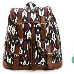"Mint and Magenta Print w Brown Trim Rucksack. NWT. Mint and magenta canvas print with soft brown synthetic leather trim. Taffeta lining with cinch top and magnetic snap closures. Lightly padded shoulder straps with top handle loop. 14"" H x 15"" W x 6"" D. 60% cotton, 40% polyester. NWT. Inside zippered pocket is big enough for your phone and keys. Outside pockets 6""H x 6""W x 2""D. Bags Backpacks"