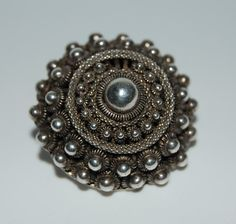 """This is a """"Zeeuwse Knoop"""". A silver button from the part of Southern Netherlands called: Zeeland. My grandparents gave me some. Netherlands Country, Antique Jewelry, Vintage Jewelry, Silver Buttons, Folk Costume, Folklore, Textures Patterns, Costume Jewelry, Holland"""