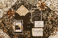 black and gold wedding invitations, photo by Hazelwood Photo http://ruffledblog.com/black-and-gold-new-years-eve-wedding #weddinginvitations #stationery