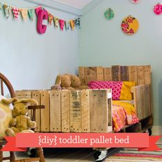 DIY Toddler Pallet Bed. I'd add a little gate that opens just to make sure they cant call out :)