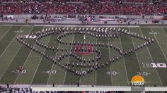 Ohio State marching band makes Superman 'fly,' T-Rex 'walk' in new video