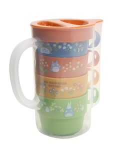 "Take a picnic party into the forest with <i>My Neighbor Totoro</i>. Four floral plastic cups stack and store inside the portable Studio Ghibli pitcher. Includes a blue, yellow, green and orange cup with handle.<div><br></div><div><ul><li style=""list-style-position: inside !important; list-style-type: disc !important"">Non BPA plastic</li><li style=""list-style-position: inside !important; list-style..."