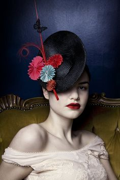 Sally-Ann Provan: Hand blocked parisisal straw saucer hat trimmed with hand-pleated hand-stitched grosgrain fan rosettes and finished with a hand-painted butterfly. Inspired by the Japanese Tea Ceremony