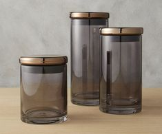 Chic in design, these modern grey glass canisters reveal the contents inside while keeping them fresh with a copper lid. Glass Canisters, Kitchen Canisters, Glass Jars, Bathroom Canisters, Coffee Canister, Canister Sets, Walk In Shower Designs, Grey Glass, Jar Storage