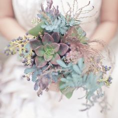 Deep colored succulents adorn this bridesmaid bouquet.  Photograph by Lydia Chen Fotography http://www.storyboardwedding.com/a-lush-mix-match-succulent-filled-chic-hipster-wedding-in-california/