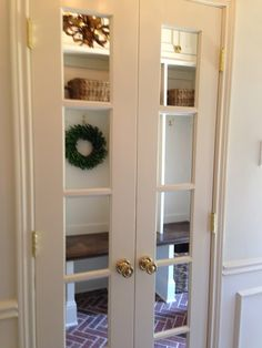 Embracing the Mundane...mirrored French doors in the laundry / mud room!  Gives such a sparkle with the brass hardware.