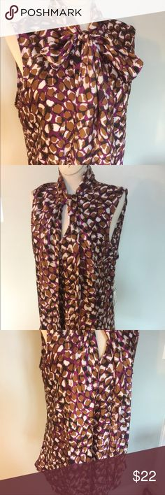NWT Nine West Sleeveless Blouse Sz L NWT Nine West Sleeveless Top/blouse,szL.Pattern is called Berry Harvest.can wear with a bow tied at neck or just handing.Great with a pants suit or with dress pants or skirt. Nine West Tops Tunics