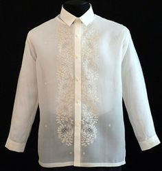 Jusi Barong Tagalog #1021  This simple embroidered Barong Tagalog is the height of good taste in formal dressing. Jusi with detailed embroidery, it creates an admirable style statement. Its shape and mandarin collar complete the effortless look. Coordinate with your best dress pant, it will be a sure winner.  Jusi Fabric  Formal fit  Straight Regular collar, cuff buttons  Traditional full-open button front     Price:  $59.99