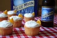 Blue Moon Cupcakes 3/4 c unsalted butter, softened 1 3/4 c sugar 2 1/2 c flour 2 1/2 tsp baking powder 1/2 tsp salt 3 eggs, room temperature 1 tsp vanilla 2 drops red food coloring 10 drops yellow food coloring 1/2 tsp orange zest 1 c Blue Moon beer 1/4 c milk Frothy White Frosting [recipe follows] small orange slices, for garnish Directions: 1. Line 24 cupcake trays with liner